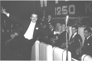 A smiling Berigan resplendent in evening clothes in front of his band in early 1941