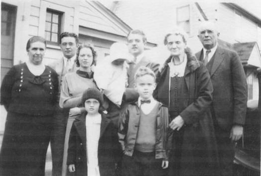 Four generations of Berigans-Fox Lake, WI June, 1933. L-R: Bunny's mother Mary Catherine (Mayme); brother Donald; wife Donna; daughter Patricia being held by Bunny; grandmother Margaret McMahon Berigan; and father, William Patrick (Cap) Berigan. The family was gathered for little Pat's baptism.
