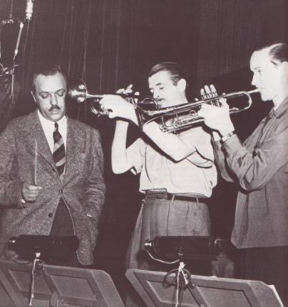 Berigan recorded many trumpet solos for the feature film Syncopation in January of 1942. Here he is pictured with film composer Leith Stevens, an old friend from CBS, and fellow trumpeter George Thow on the soundstage at RKO in Hollywood.