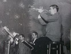 Berigan caught at the Valencia Ballroom, York, Pennsylvania on Thanksgiving night, November 24, 1938. The saxophonists L-R are probably Charlie DiMaggio (subbing that night), and definitely Gus Bivona. Note Berigan playing fron a high stool: this was necessary because at the time he was nursing a broken ankle.