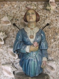 Ship's figurehead from the Figurehead Museum, Tresco Abbey Gardens