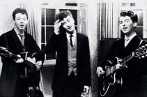 Paul McCartney, John Lennon & George Harrison performing at a wedding reception, 1958.