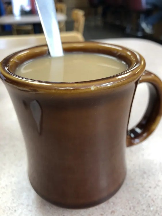 Coffee in a coffee mug with a spoon