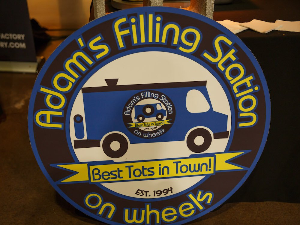 Adam's Filling Station on Wheels Sign