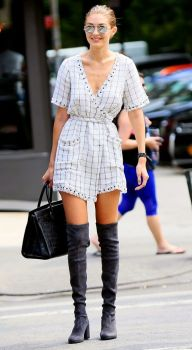 New York, NY - Model of the moment, Gigi Hadid, is back in NYC and on the go as usual! The 21-year old blonde bombshell looks ultra stylish in a white wrap tie dress paired with statement making thigh high boots. Hadid is leaving her NYC apartment to hang with a friend in the city. AKM-GSI September 5, 2016 To License These Photos, Please Contact : Maria Buda (917) 242-1505 mbuda@akmgsi.com sales@akmgsi.com or Mark Satter (317) 691-9592 msatter@akmgsi.com sales@akmgsi.com www.akmgsi.com