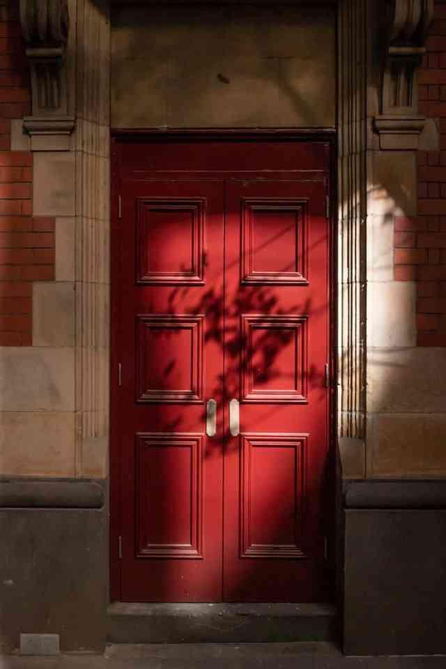 red wooden door on daylight