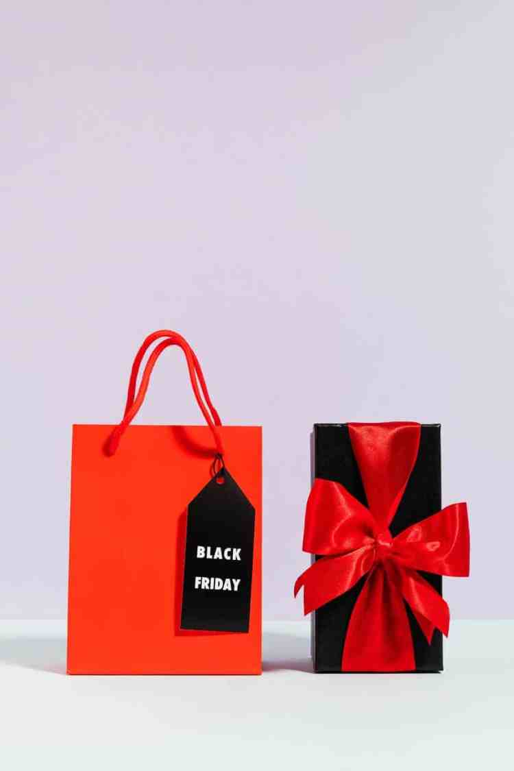 red paper bag beside a present