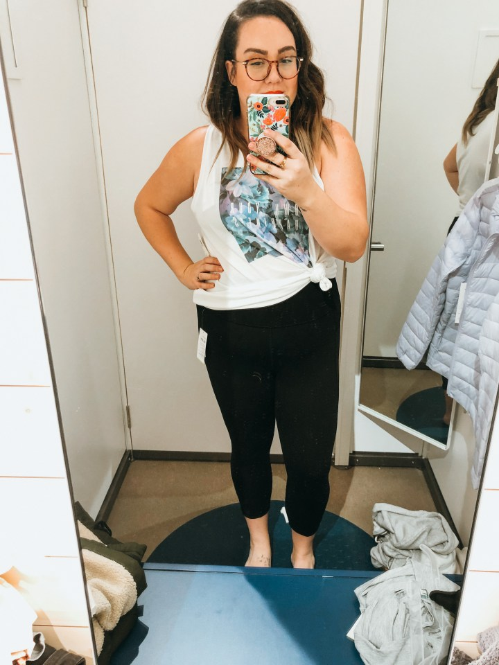 Lady in fitting room trying on clothing at old navy