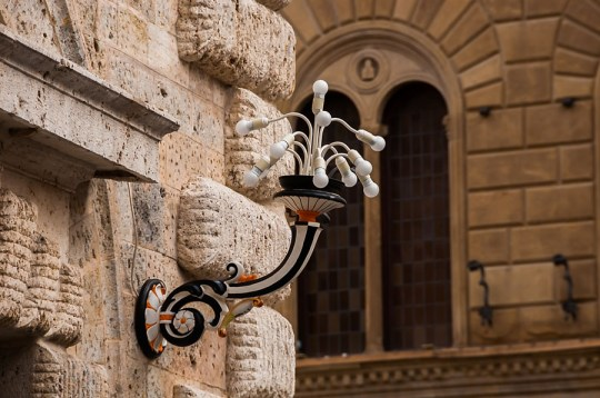 Contrada-colored street lamp, Siena, Italy