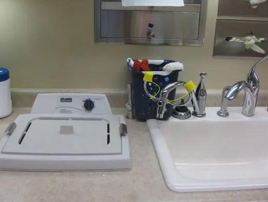 Ultrasonic debris removal before sterilization
