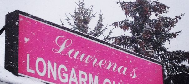 Bright pink sign outside Laurena Longarm Quilting Burlington Boston