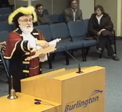 Town Crier David Vollick reading the message from Gazette publisher Pepper Parr at Council in December of 2011.