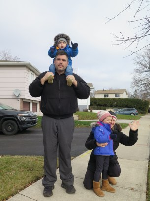 Gibbons Dec 13 Dad with child shoulder