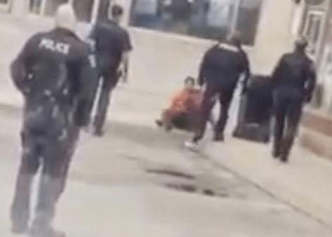 Police officer assaulting man in Oakville
