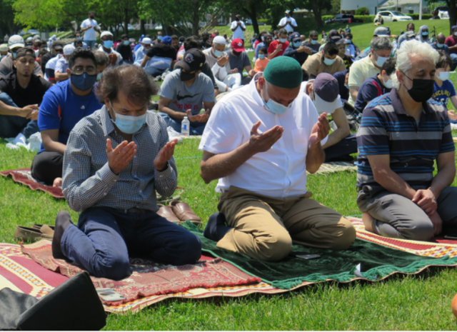 Muslims participating in Call to Prayer