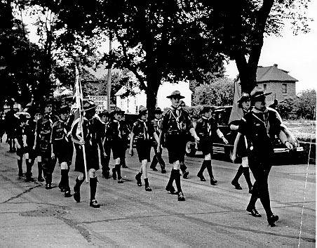 Ist Company Burlington Boy Scouts on parade with scoutmaster George Johnson, 1950