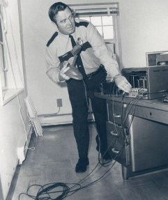 Officer Andrew Reilly in Burlington's new police HQ, 1970