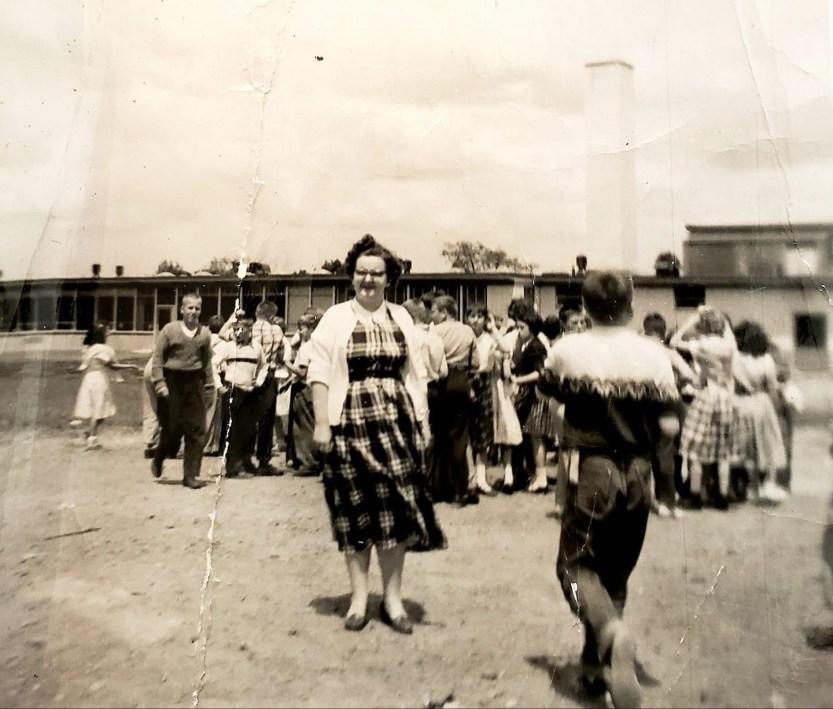 Teacher Jane Skelton behind Memorial School c. 1955, Burlington MA