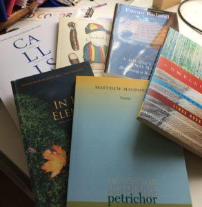 paperbacks fanned across my desk