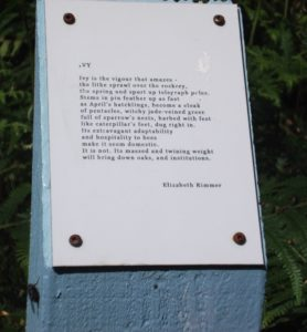 blue post with poem on it