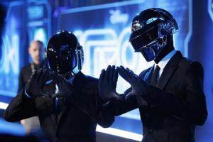 "Musicians Banglater and de Homem-Christo of Daft Punk pose at the world premiere of the film ""TRON: Legacy"" in Hollywood, California"