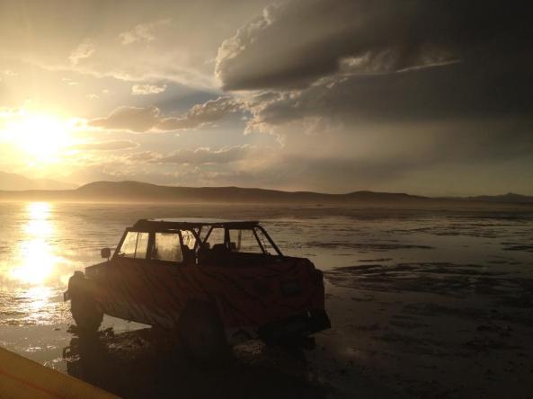 car in wet playa