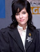 Parker Posey suits up, with a silver star