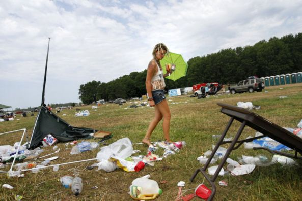 A raver surveys the MOOP left over after Electric Forest 2015. Image: MILive