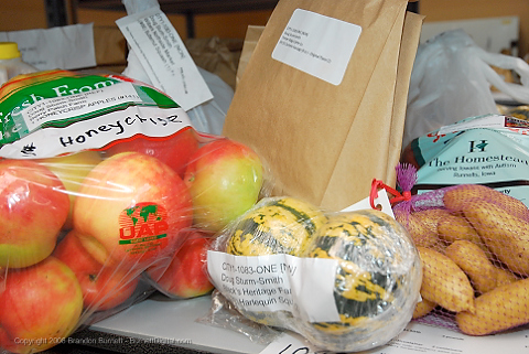 A variety of products available through the Cooperative. The first delivery day of the Iowa Food Cooperative at Merle Hay Mall. The Iowa Food Cooperative allows consumers to order local products online from Iowa producers and then pick them up at a storefront in Merle Hay Mall.