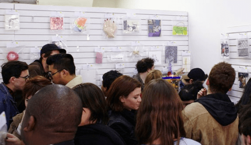 People who thought they were crowding in to buy cheap-o items, but instead got stuck looking at art