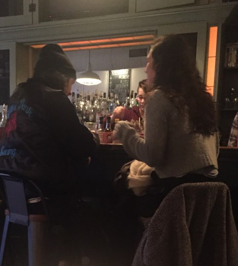 Just one of many wintertime couples hanging on to show PDA at a bar