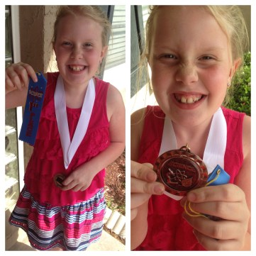 My sweet girl was so excited to win that medal.