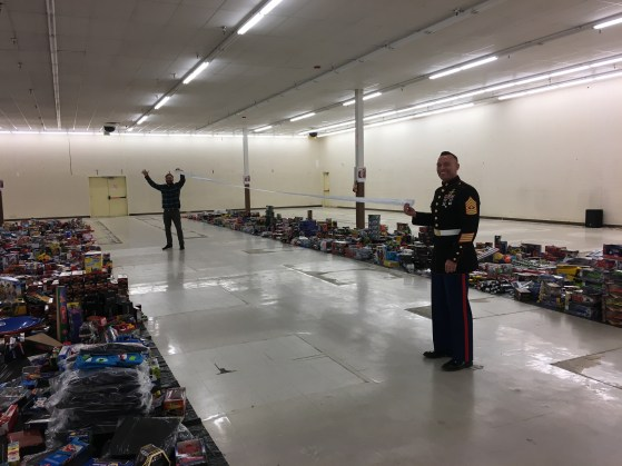 Luc and First Sgt. Finney stretch the receipt in the distribution center.