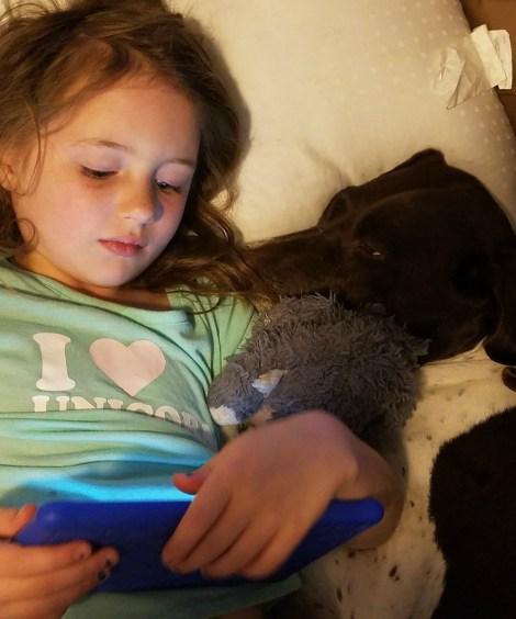 tired girl and dog