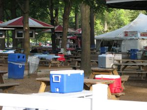 Coolers claiming picnic tables at Saratoga Racetrack, 10 am