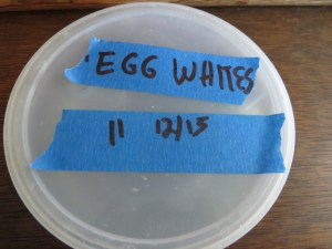 I keep my leftover eggs in a leftover deli 1 cup tub, and write on the top how many and when I added them.
