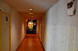 The heart of a city's night life beats behind the doors at the end of these lifeless corridors.