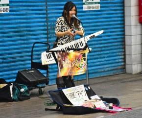 Street musician with badass keytar