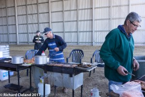 "Bob Taylor becomes ""The Chook Man"" for the day as he carefully cooks the chicken steaks"