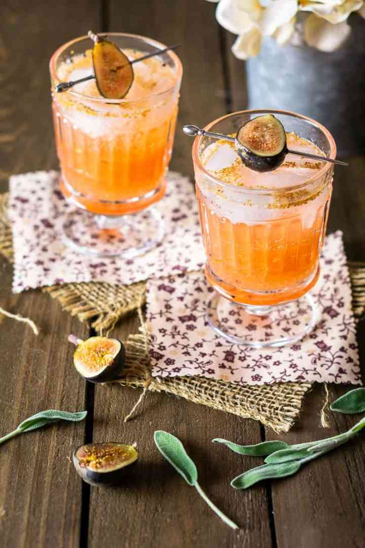 Two sage-fig cocktails with flowers.