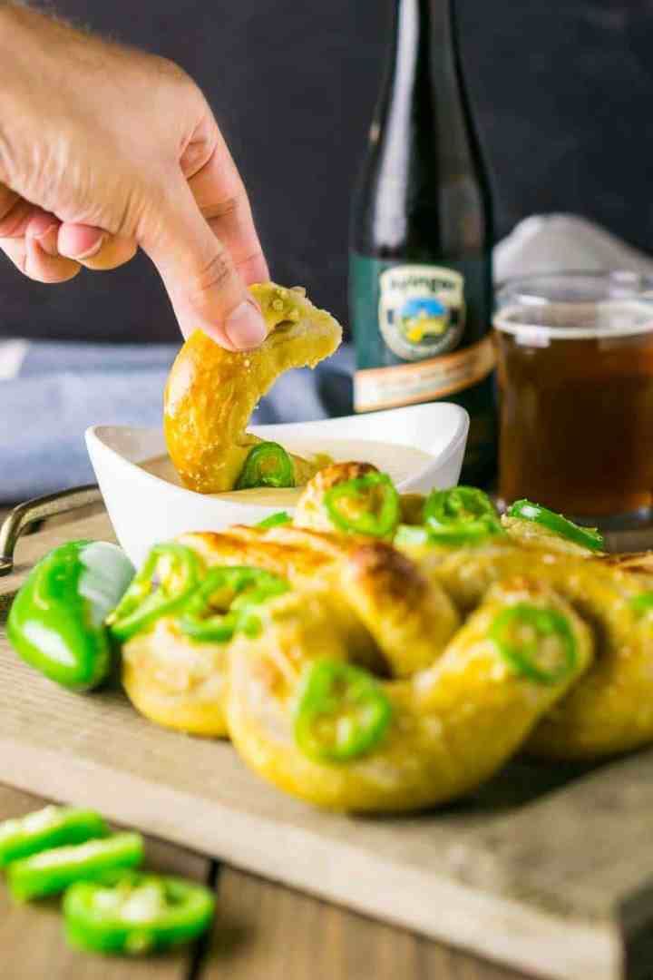 Dipping soft beer pretzels into Oktoberfest cheese dip.