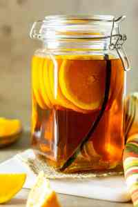 Vanilla bean-orange-infused bourbon in a jar