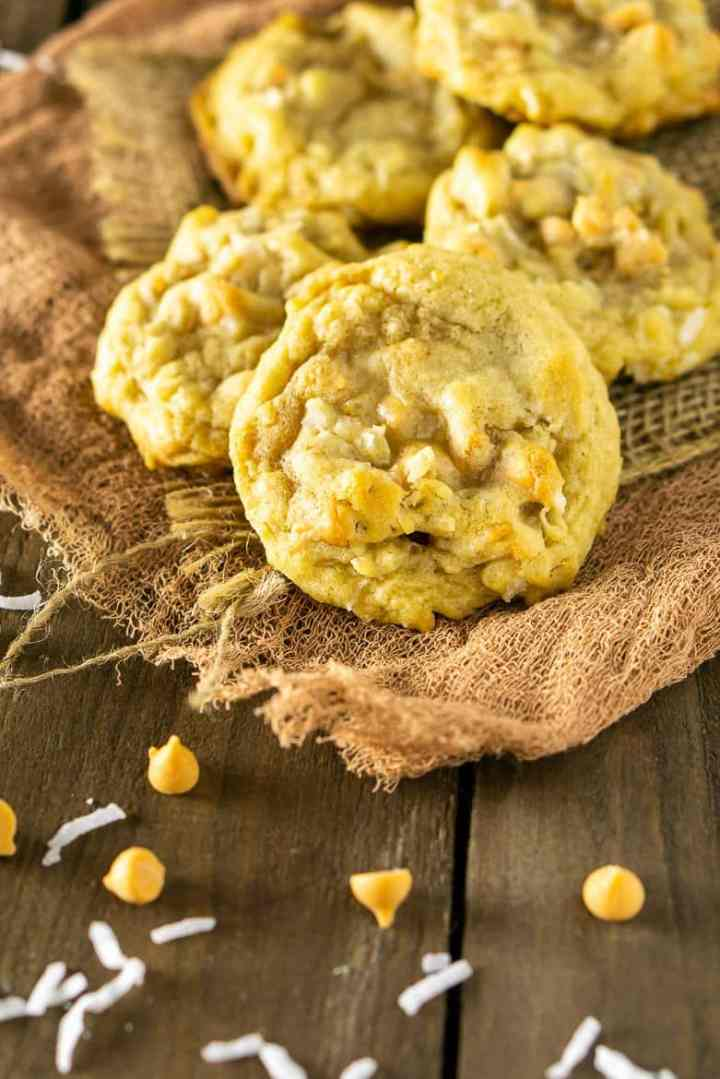 A pile of butterscotch-coconut-bourbon cookies on burlap.