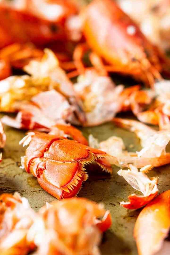 A large sheet pan with sea fish shells to roast for the homemade seafood stock.