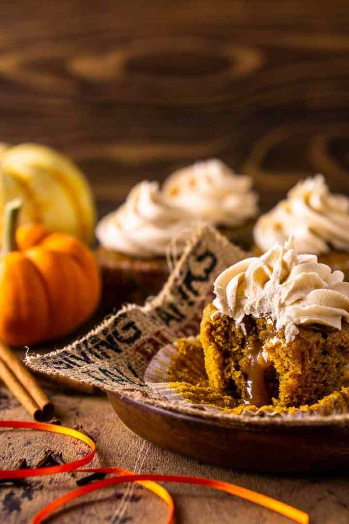 A brown butter-pumpkin cupcake with bourbon caramel oozing from the center.