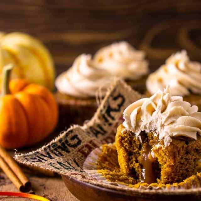 A brown butter-pumpkin cupcake with bourbon caramel oozing from the center.