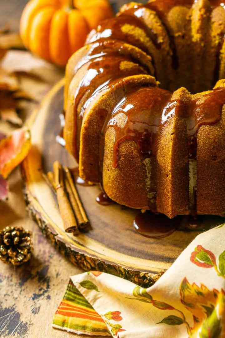 Looking down at the buttermilk-pumpkin pound cake with caramel running off it.