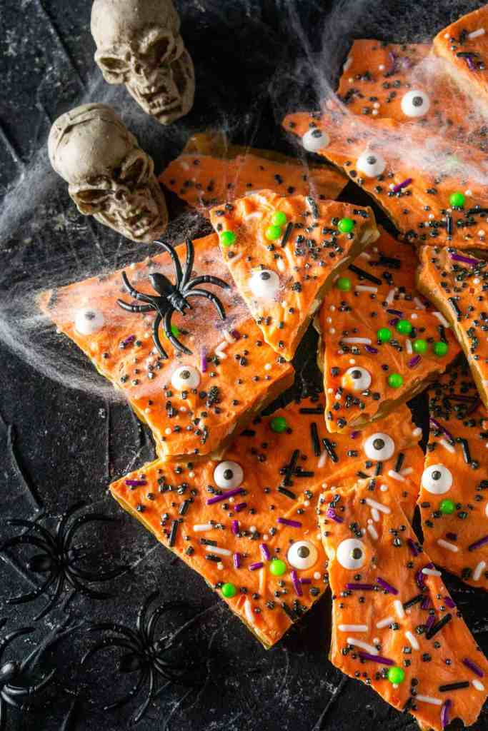 An aerial view of the Halloween toffee with spider webs and skulls on the side.