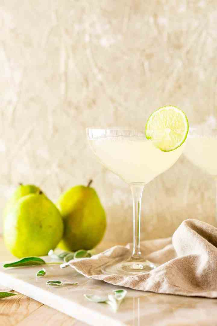 Looking straight on of the fall gimlet with pears behind it.