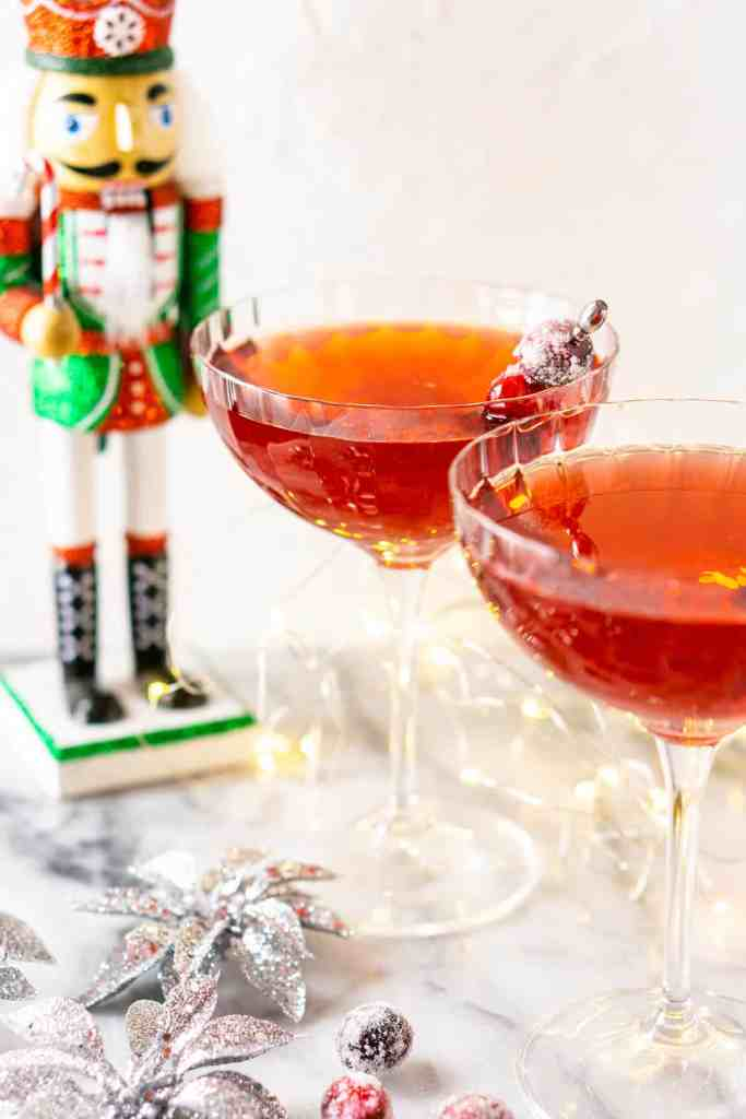 A Sugar Plum Fairy Martini with another on the side with silver ornaments.